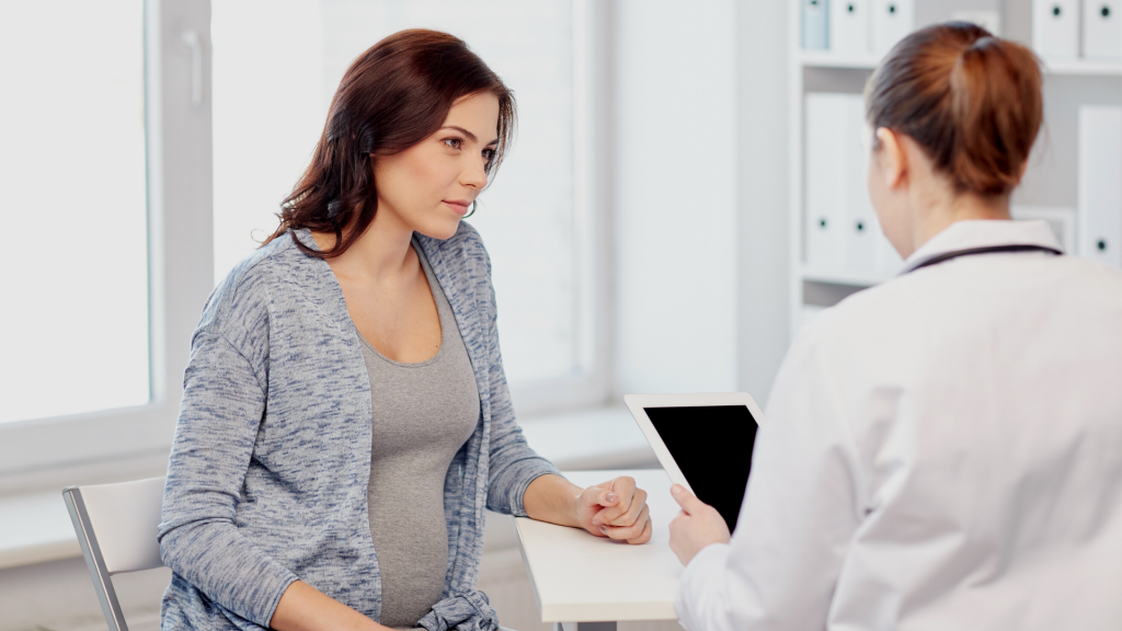 Pregnant woman talking to Health Care Provider